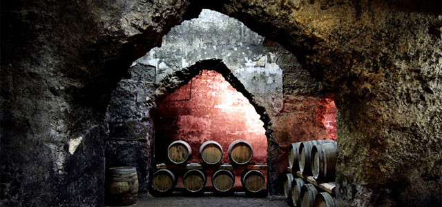 Wine-aging barrels in an ancient Roman cistern. From casteldepaolis.it