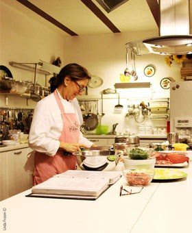 Lella at work in the kitchen. Photo courtesy of scuoladicucinadilella.net