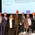 Speakers of the World Bridge Tourism London conference posing for a group photo after their panel discussion